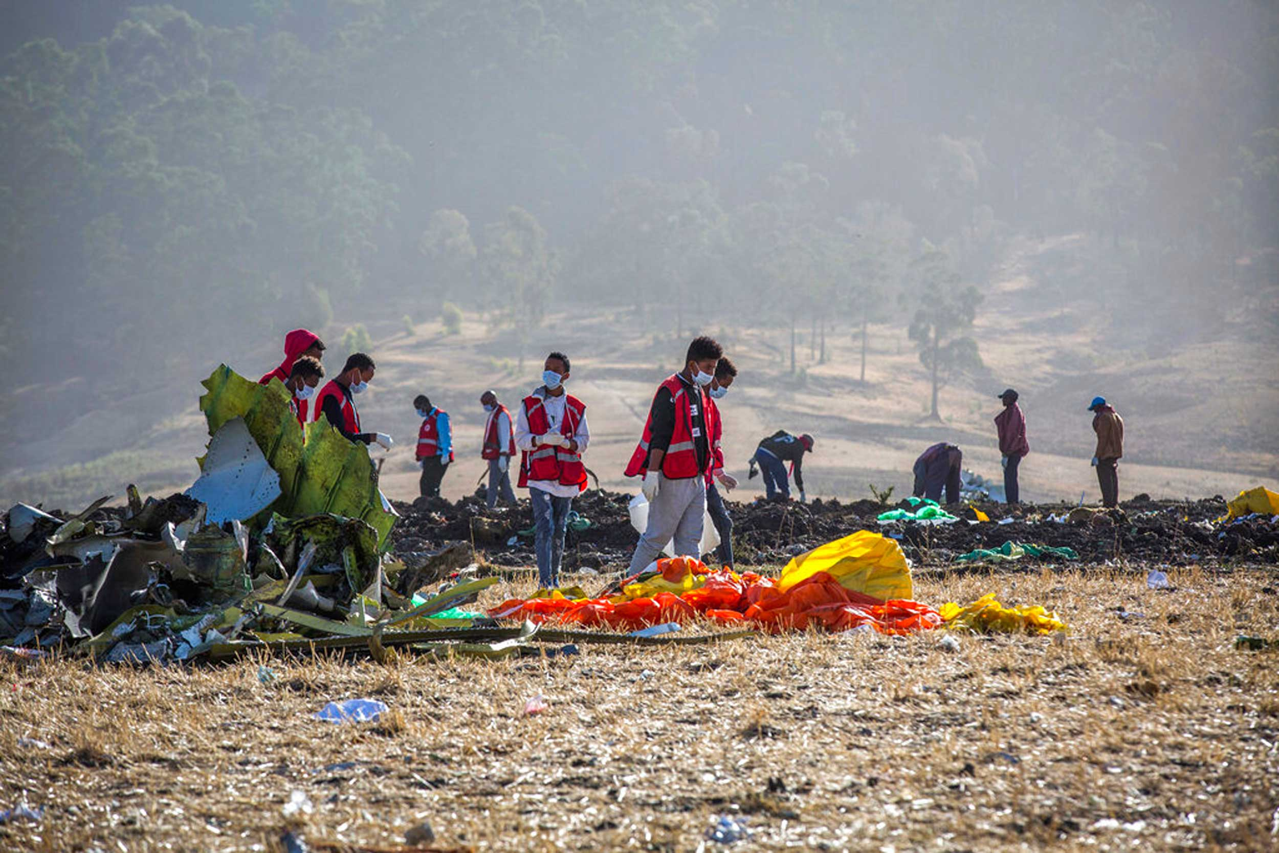 Emergency personnel at the scene of an Ethiopian Airlines flight crash near Bishoftu, or Debre Zeit, south of Addis Ababa, on March 11, 2019.