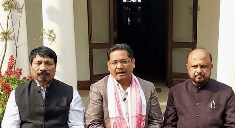 Conrad Sangma, flanked by AGP leaders, in New Delhi on Wednesday.