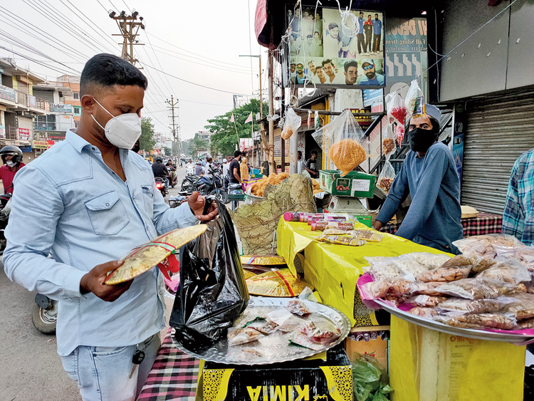 A man buys dry fruits from a shop at Bariatu in Ranchi on Sunday ahead of Id.