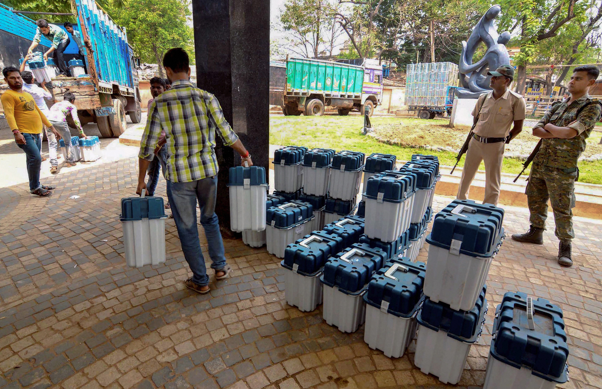 Workers load Voter-verified paper audit trail (VVPAT) machines in a truck, ahead of the Lok Sabha elections, in Birbhum on Sunday, March 31, 2019.