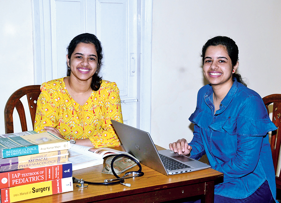 Namrata and Nandita at their study table