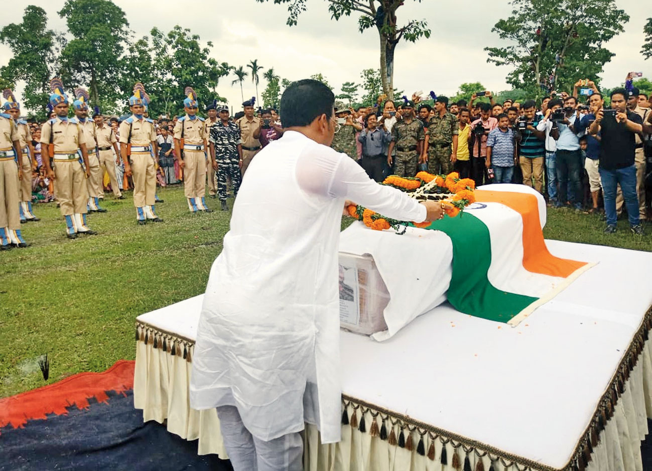 Doley lays a wreath and jawans lead the procession at Kamalpur on Saturday.