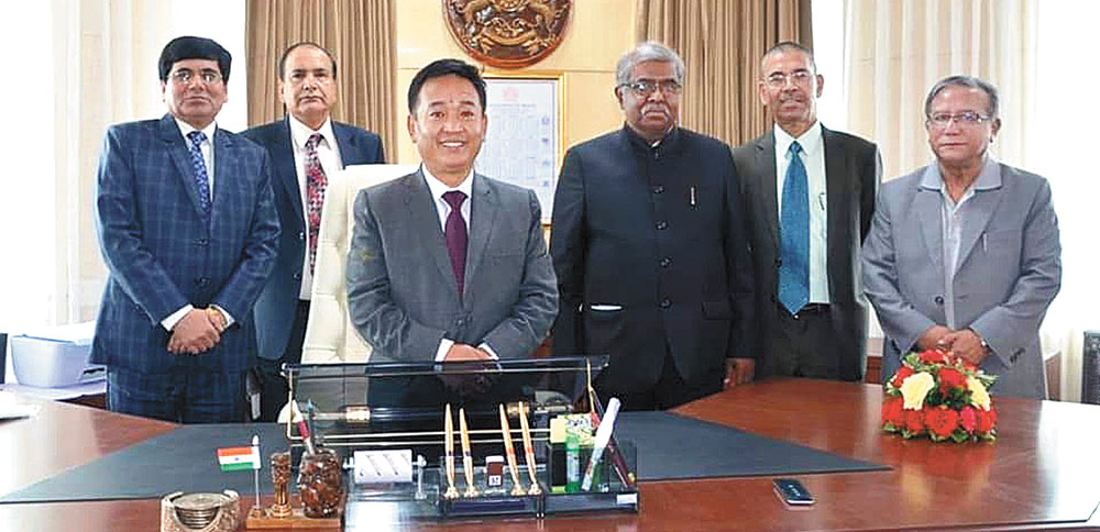 Golay with officials in his Gangtok office on Thursday