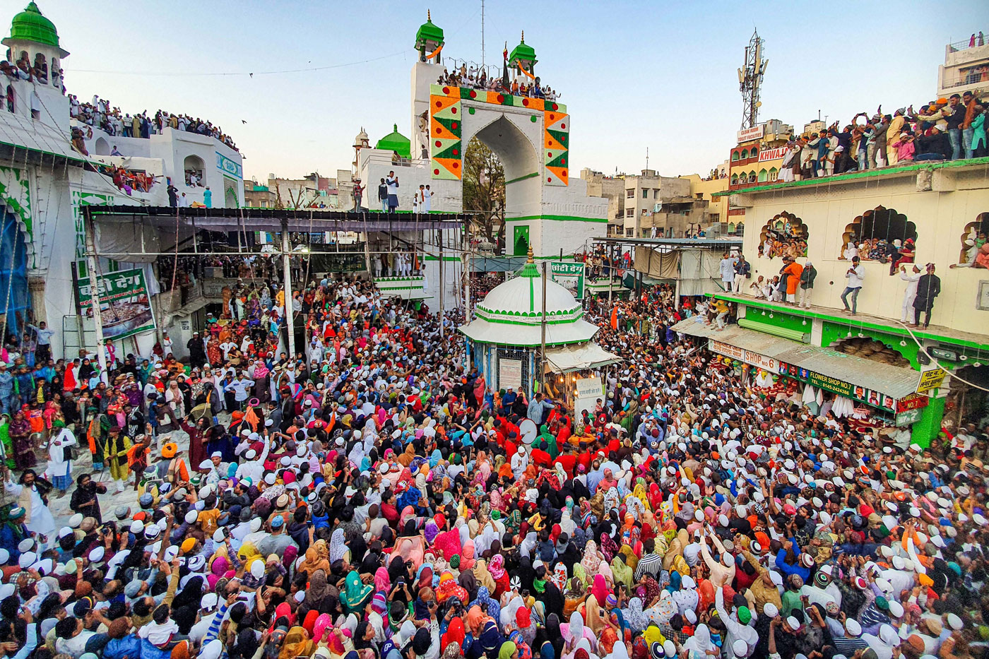 Muslim devotees gather to attend the flag hoisting ceremony ahead of the annual urs at Ajmer dargah in Ajmer, Rajasthan