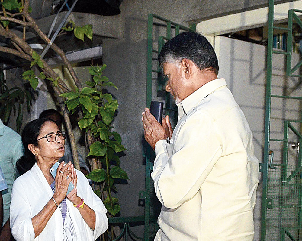 Mamata and Naidu greet each other at her residence in Calcutta on Monday.