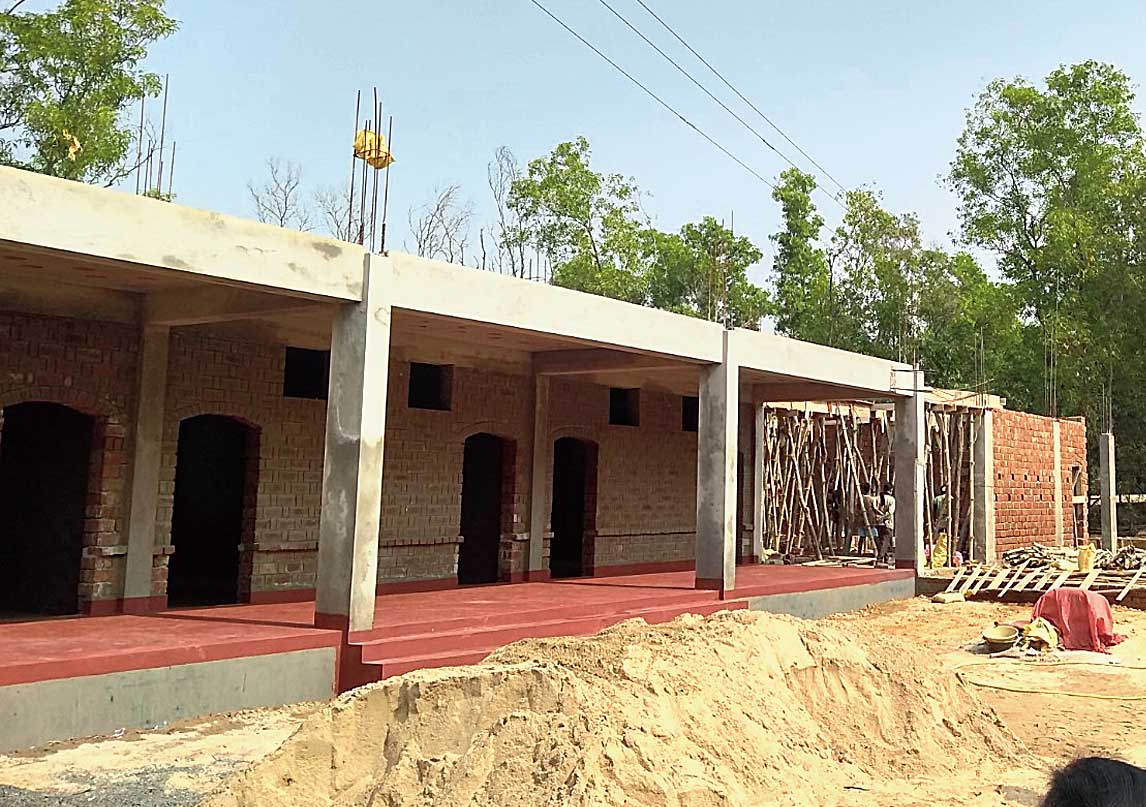 The under-construction school building.
