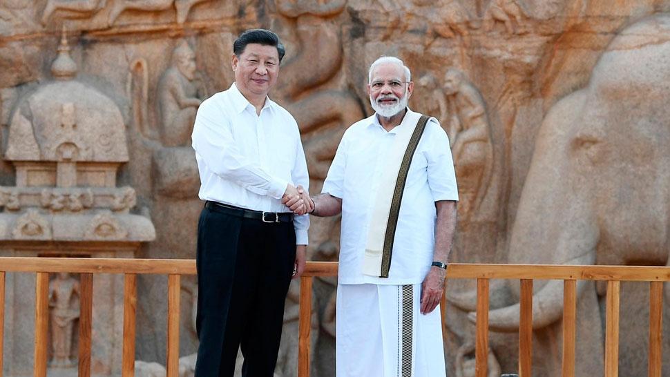 Xi Jinping and Narendra Modi shake hands at Arjuna's Penance in Mamallapuram.
