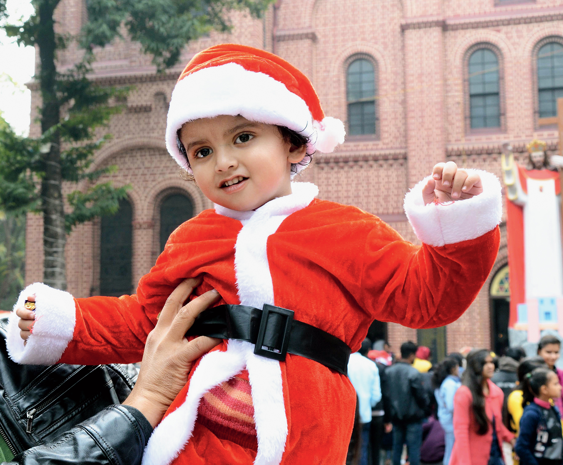 A toddler dressed as Santa Claus at St Mary's Cathedral in Ranchi on Wednesday.