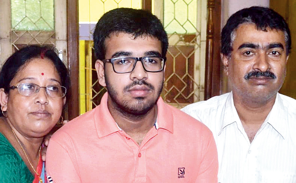 Nilanjan Deb with his parents in Agartala on Thursday.