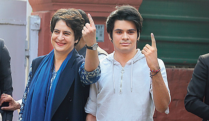 Priyanka Gandhi with her son Raihan, who voted for the first time, at a polling station in New Delhi.