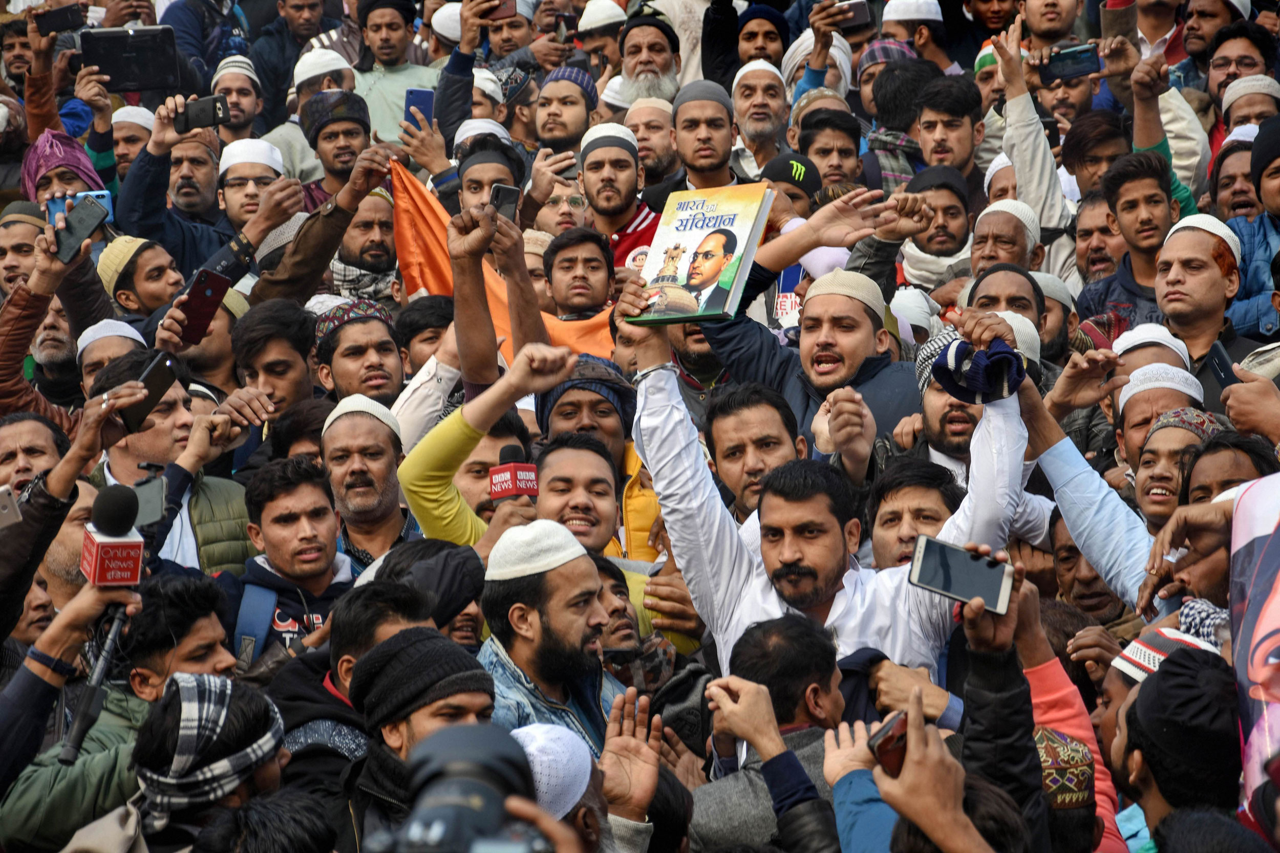 Bhim Army chief Chandrashekhar Azad (in white with both hands raised) along with others protests against the Citizenship (Amendment) Act at Jama Masjid in New Delhi on December 20, 2019.