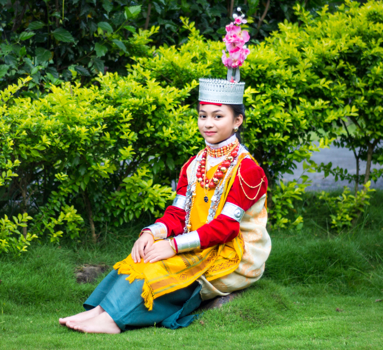 A young Khasi girl dressed in traditional attire.