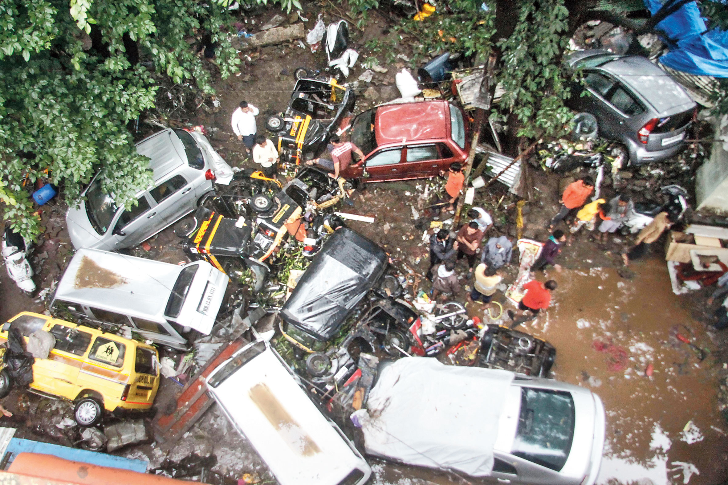 Vehicles are piled up on a street following heavy rain in Pune on Thursday.