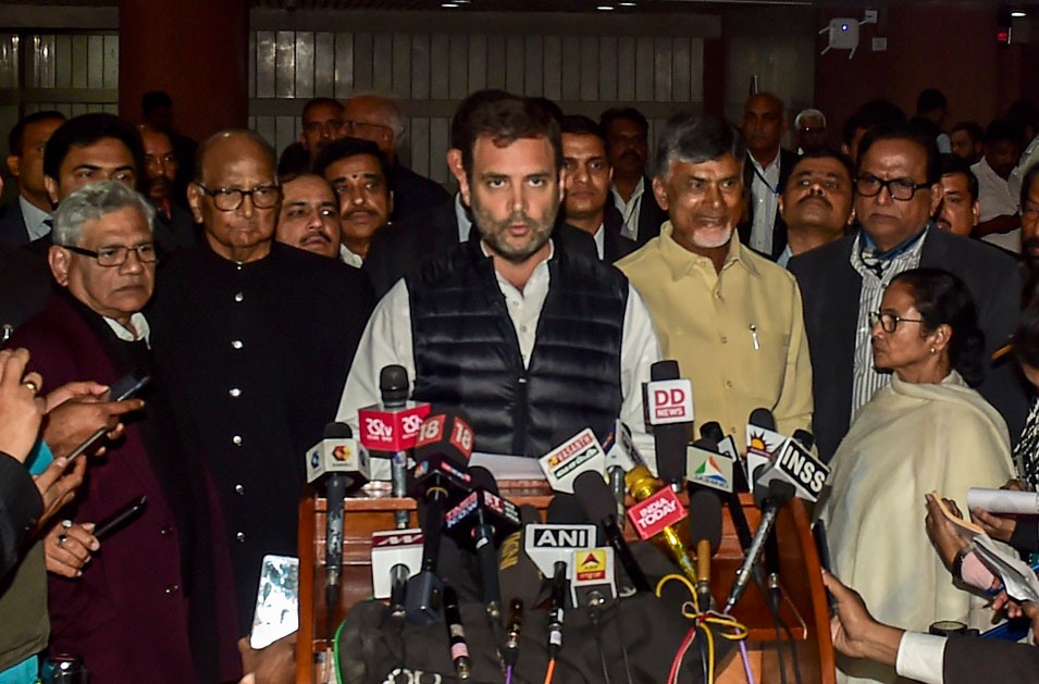 Congress president Rahul Gandhi reads a joint statement after the Opposition parties' meeting in New Delhi on Wednesday.