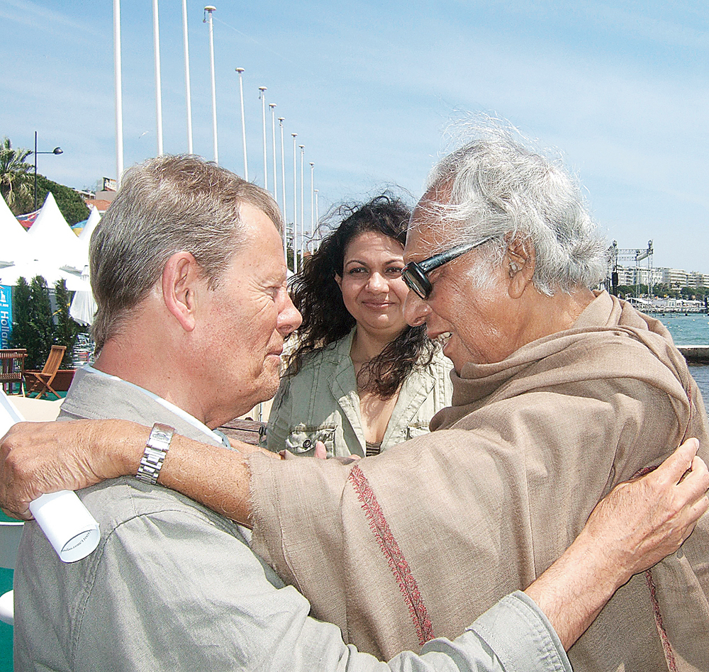 Mrinal Sen (right) greets Derek Malcolm at Cannes in 2010