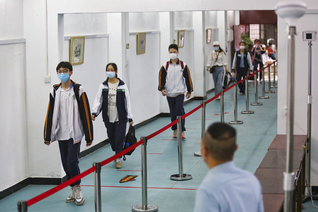 Students wearing protective masks maintain social distancing at a high school in Wuhan.