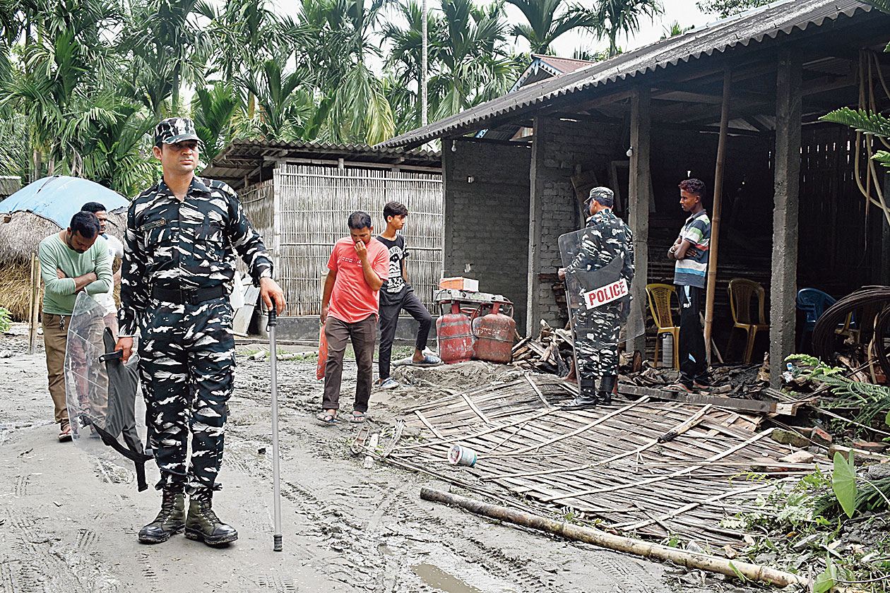 Paramilitary forces cordon off the house where the incident took place at Ganakpara.