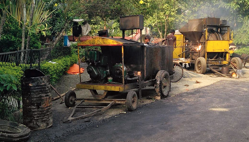 A hot mix plant in use as roads are being repaired in IA Block