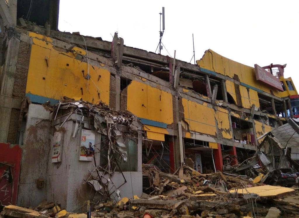A department store building heavily damaged by the earthquake in Palu, Indonesia