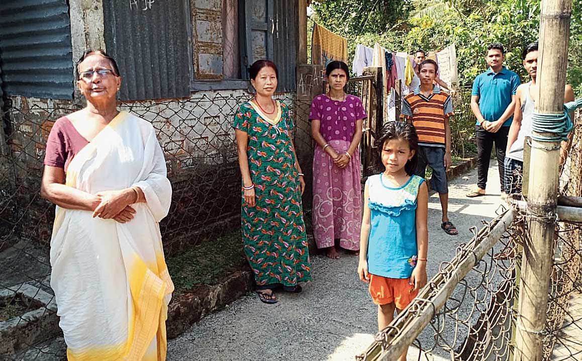 Members of a family outside their quarters of Cachar Paper Mill.