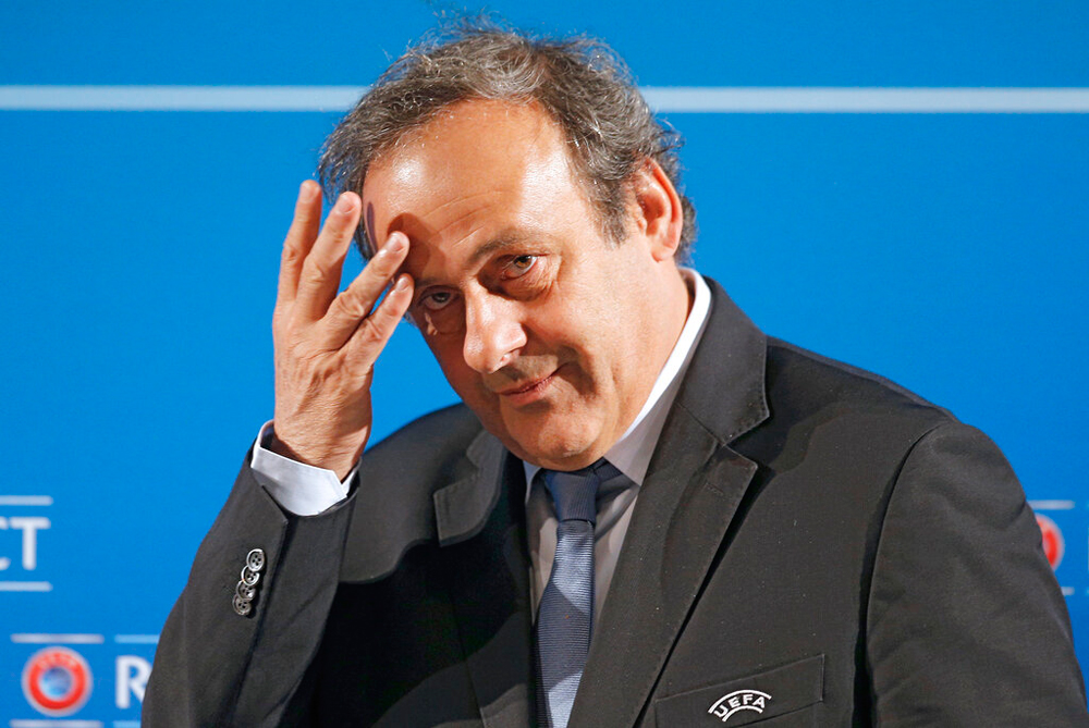 Michel Platini was being questioned over the awarding of the 2022 World Cup soccer tournament to Qatar