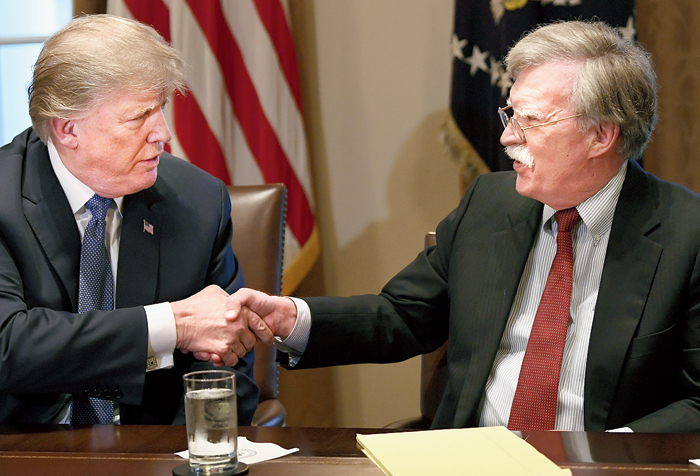 President Trump (left) and John Bolton at the White House on April 9, 2018
