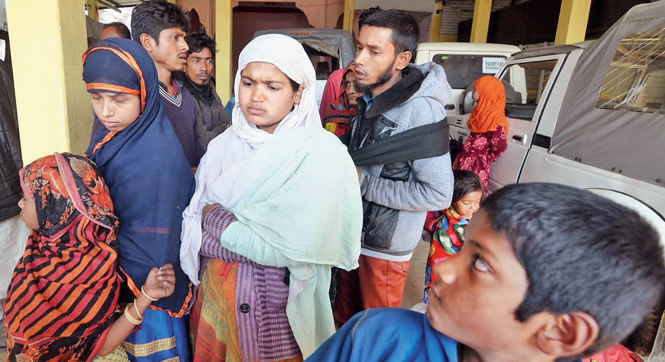 Some of the Rohingya at a police station in Karimganj district on Tuesday.