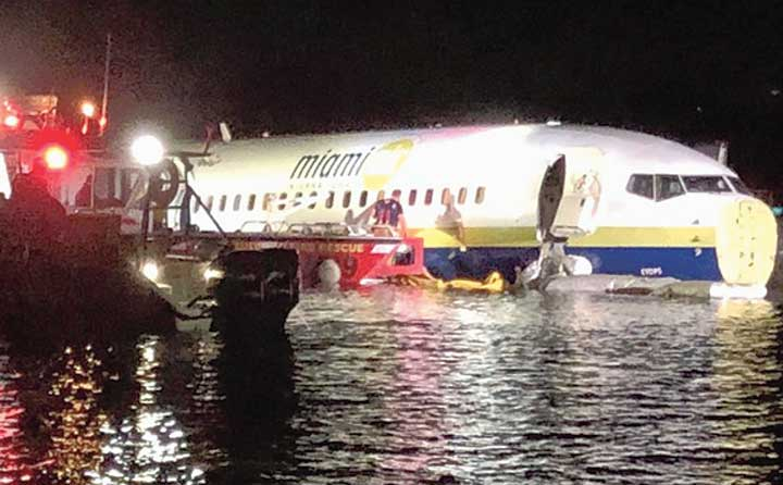 A picture released by the Jacksonville Sheriff's Office shows rescuers at the site where the Boeing 737 skidded into the river in Jacksonville.
