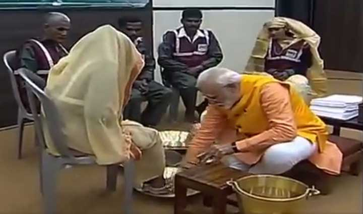 Footage shows Narendra Modi washing the feet of sanitation workers in Allahabad on February 25, 2019.