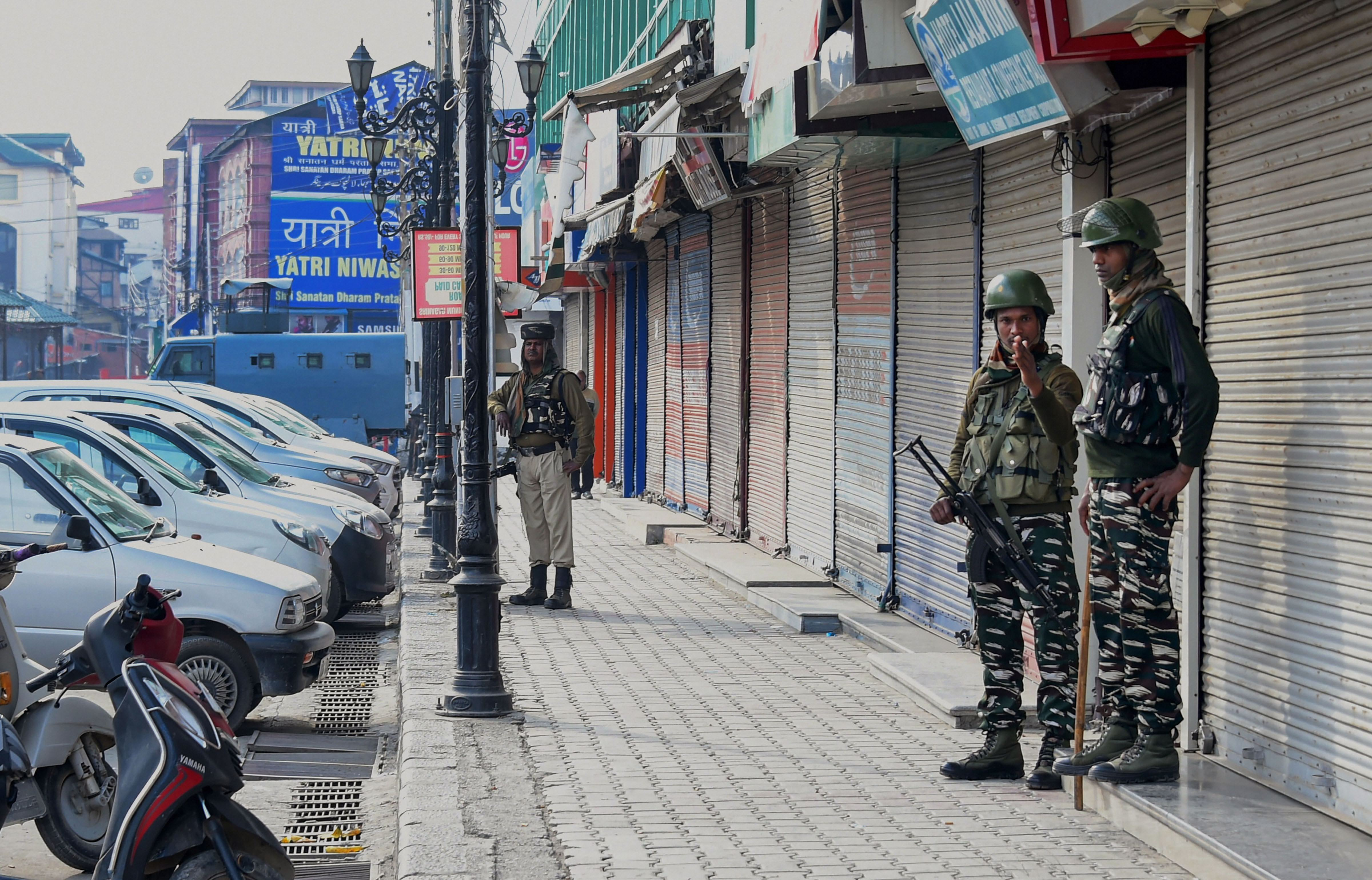 Security personnel stand guard during restrictions in Srinagar, Monday, Oct. 28, 2019.
