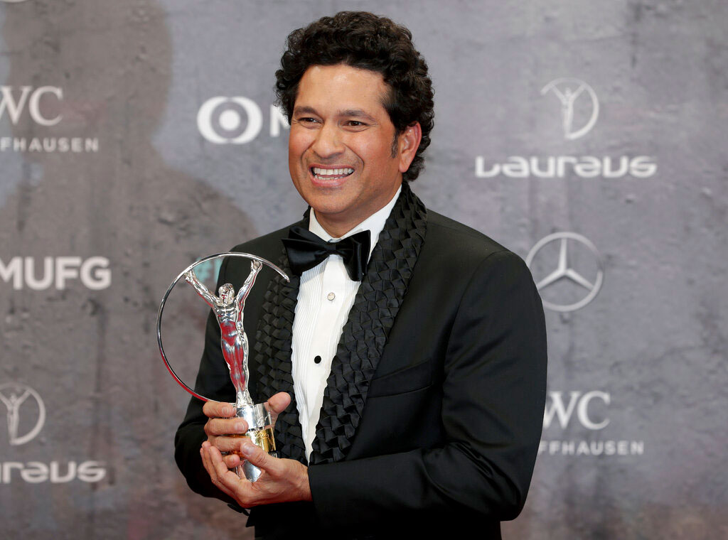 Sachin Tendulkar poses with the 'Best Sporting Moment Award' during the 2020 Laureus World Sports Awards in Berlin on Monday