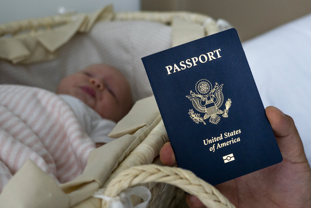 In this photo taken on January 24, 2019, Denis Wolok, the father of 1-month-old Eva, shows the child's US passport