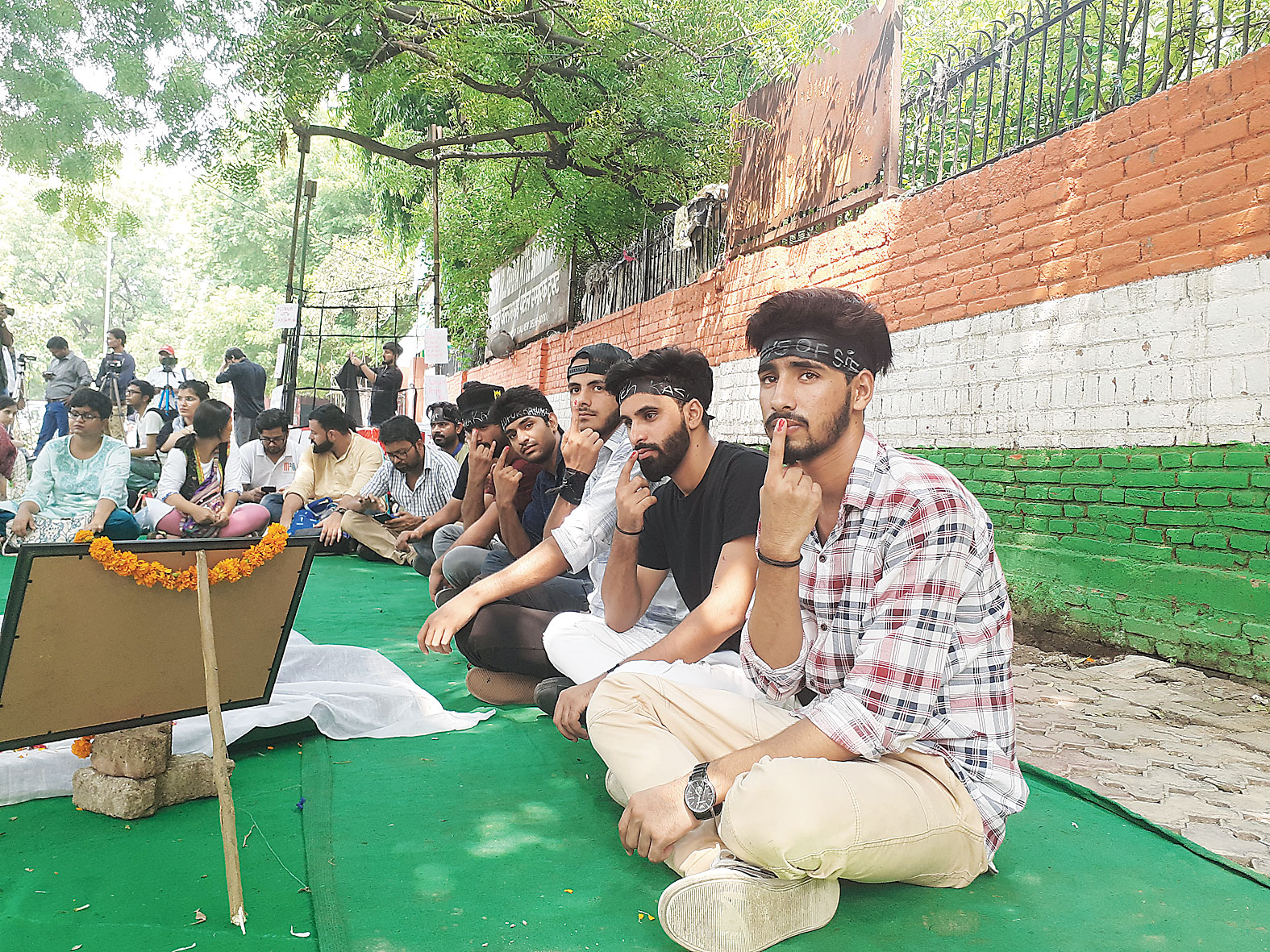 Several Kashmiri students in New Delhi observed Muharram by marking their fingers with red ink and wearing black bandanas on Jantar Mantar Road.