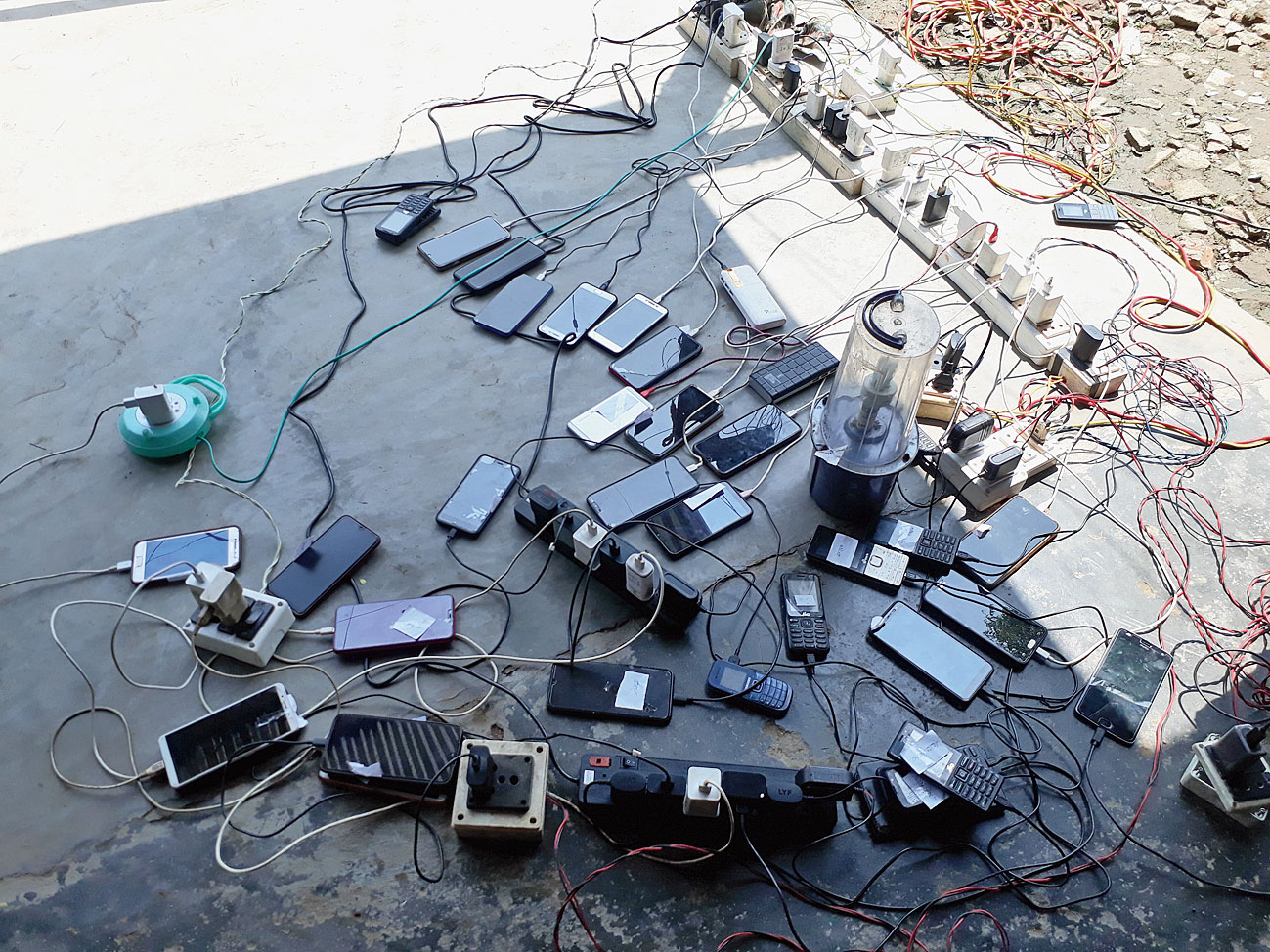 Cellphones being charged with a generator at Santipur.