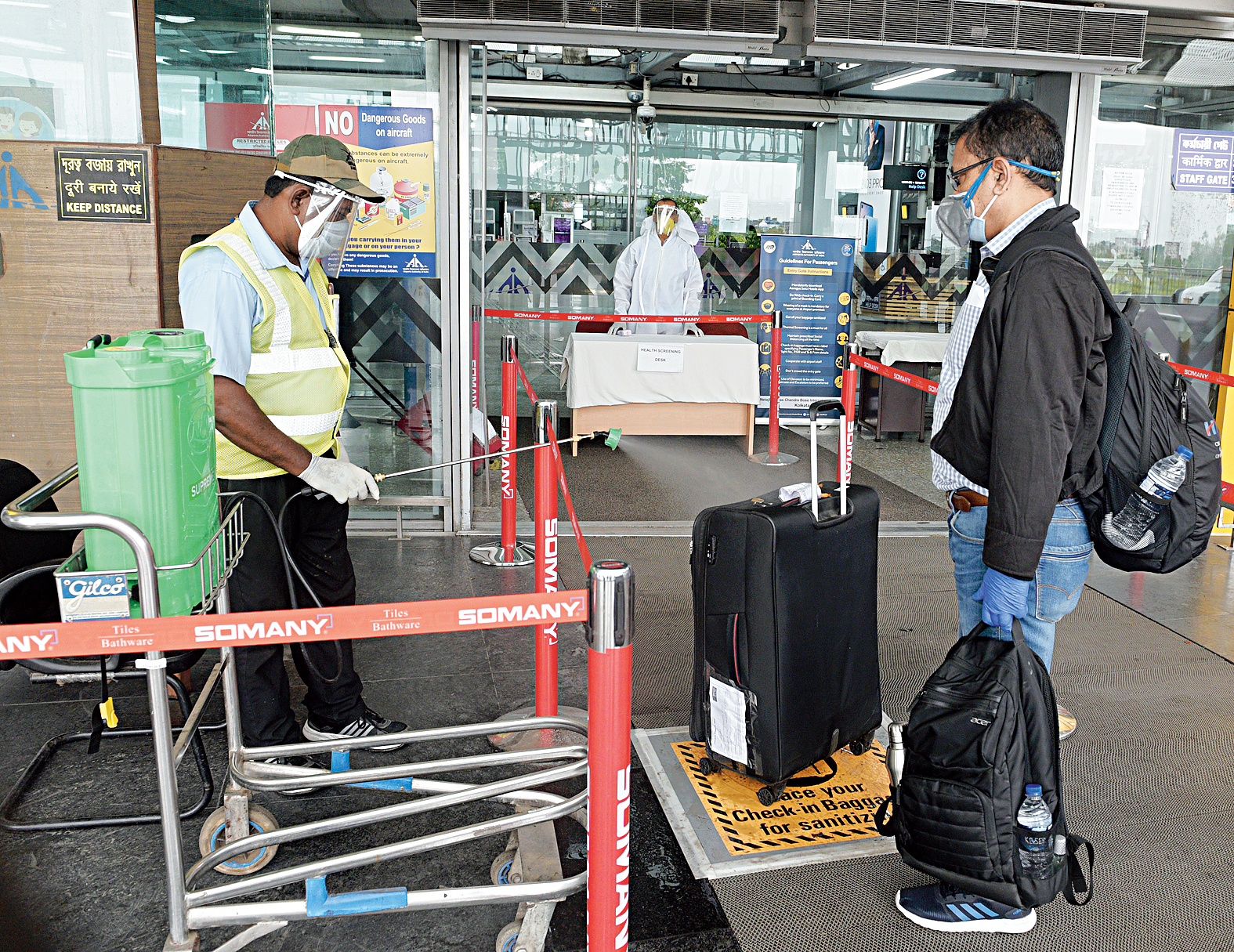 Sanitiser spray awaits passenger's bags at the entrance of the terminal. Both check-in and cabin baggage are sanitised.