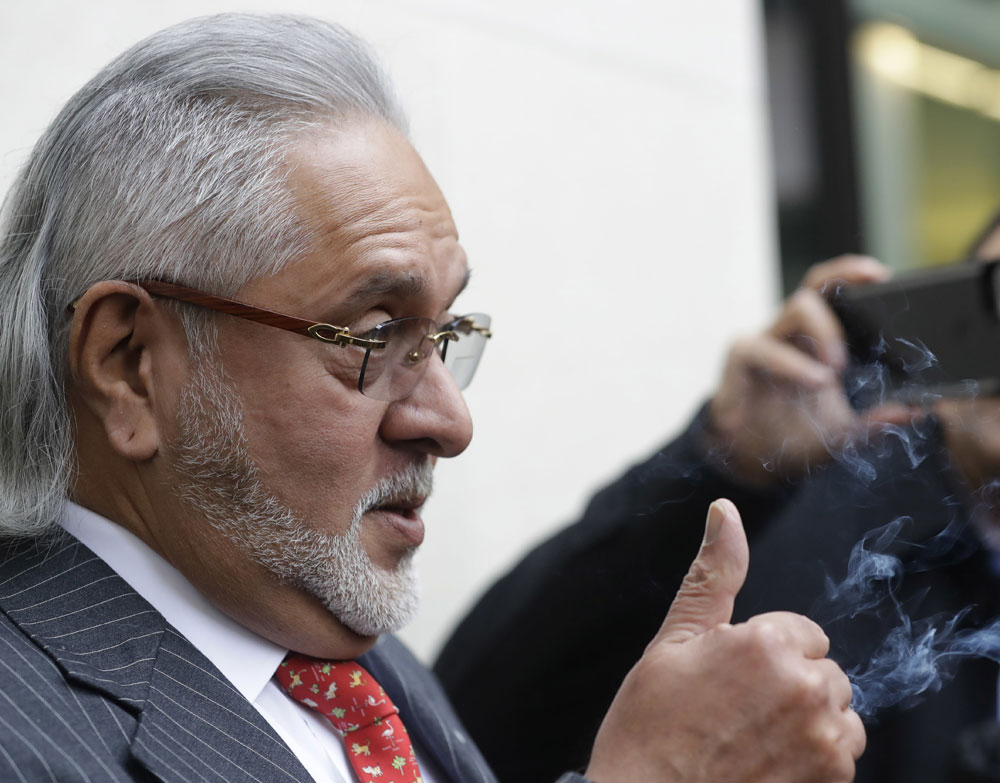 Vijay Mallya chats with the media outside the Westminster Magistrates Court in London on Monday.