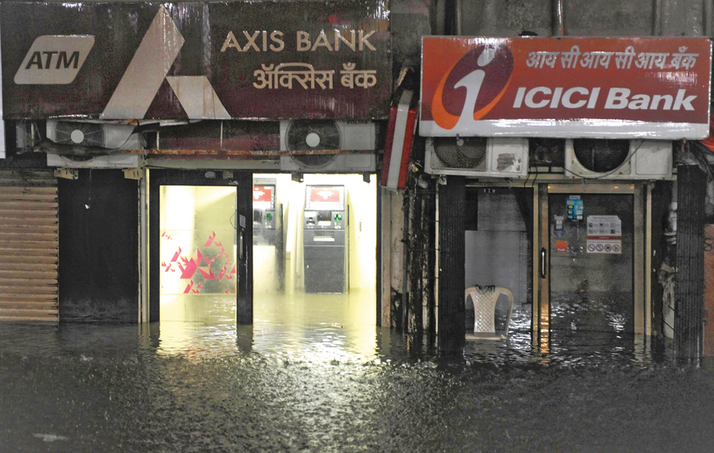 Waterlogging at ATMs following heavy rain in Maharashtra's Palghar district on Tuesday