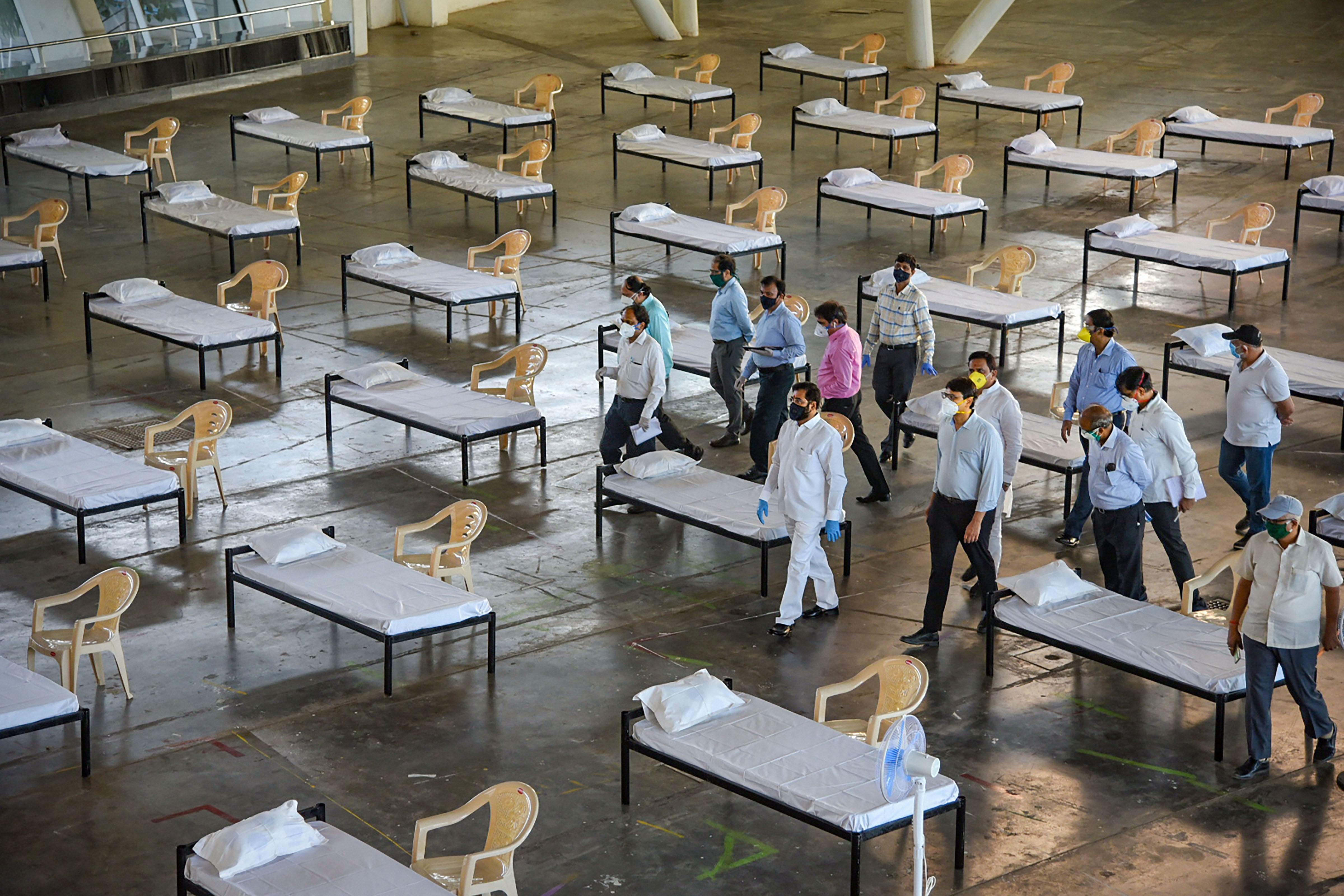 Thane guardian minister Eknath Shinde inspects a Covid-19 quarantine facility at CIDCO Exhibition Center in Navi Mumbai on Thursday.