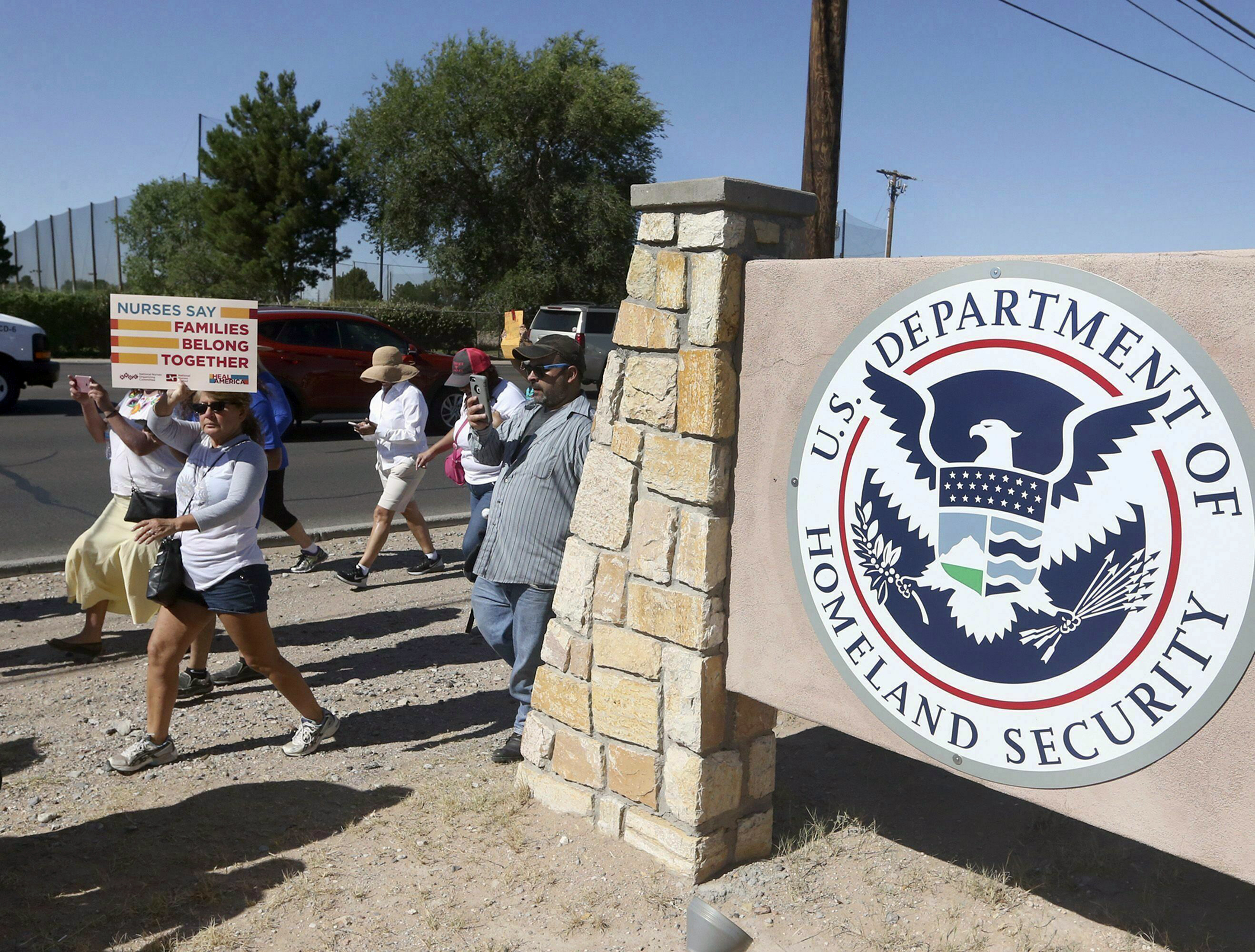 This June 2018 file photo shows protesters walking along Montana Avenue outside the El Paso Processing Center in Texas.