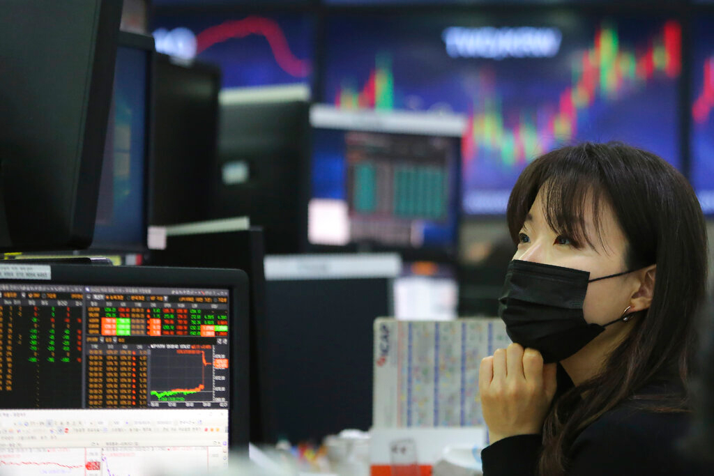 A trader at the foreign exchange dealing room of the KEB Hana Bank headquarters in Seoul, South Korea, on Friday.