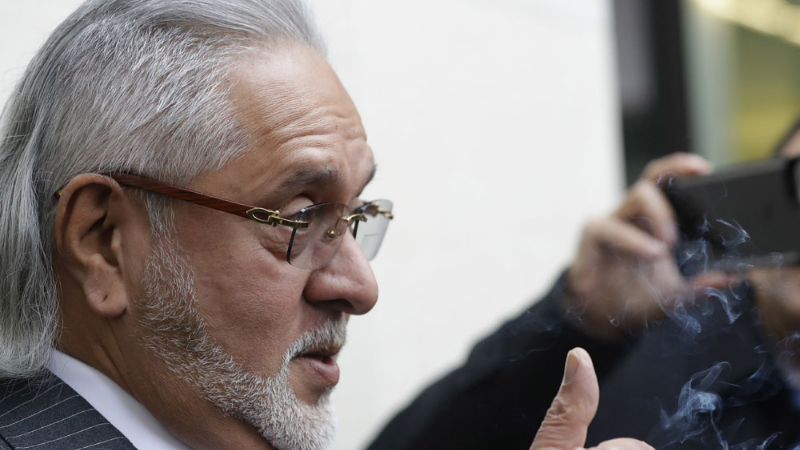 Vijay Mallya chats with the media outside the Westminster Magistrates Court in London on Monday, December 10, 2018
