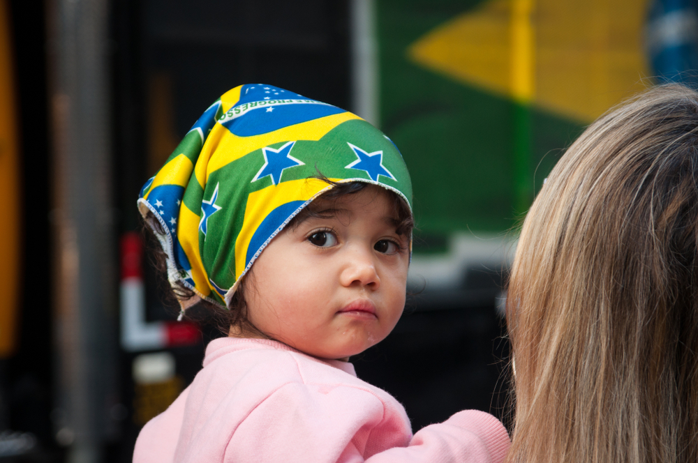 A girl wears a Brazilian flag at a demonstration supporting Jair Bolsonaro in Sao Paulo, Brazil, in October 2018. Bolsonaro ascended to the highest office of South America's largest country through a visceral campaign that targeted political elites, minorities, women and LGBTQ people