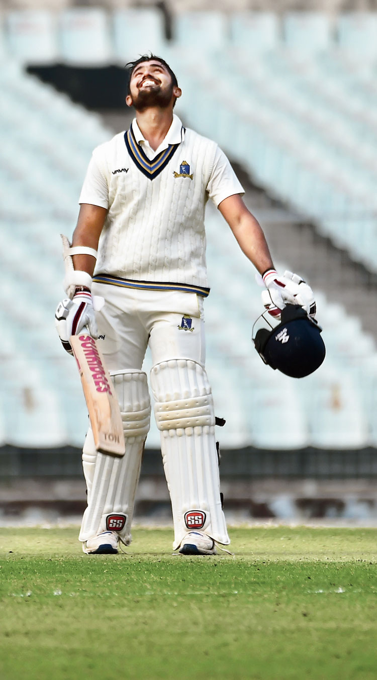 Abhishek Raman celebrates after his century at the Eden on Wednesday