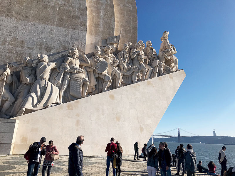 Monument of discoveries — a ship with all the prominent historic explorers
