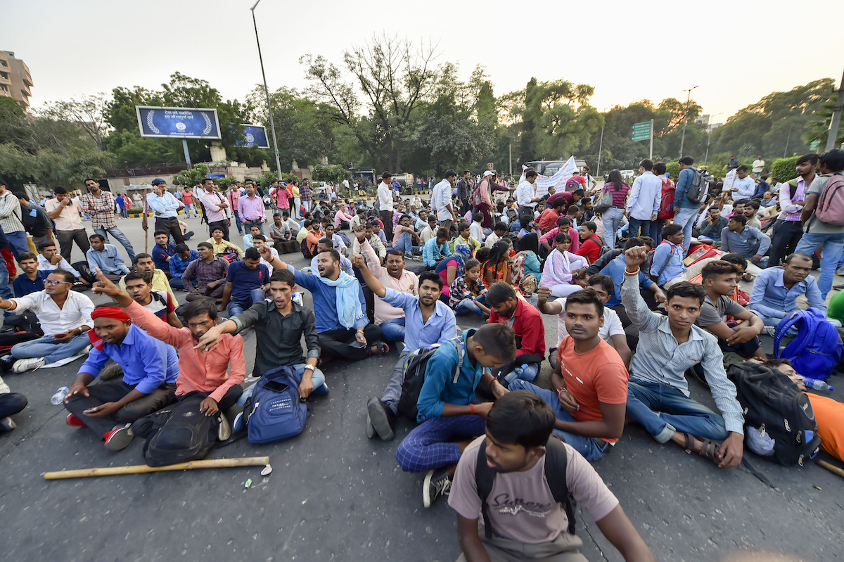People with disabilities block a road and raise slogans to protest the invalidation of railway examination results, near Mandi House in New Delhi, on Wednesday, October 23, 2019