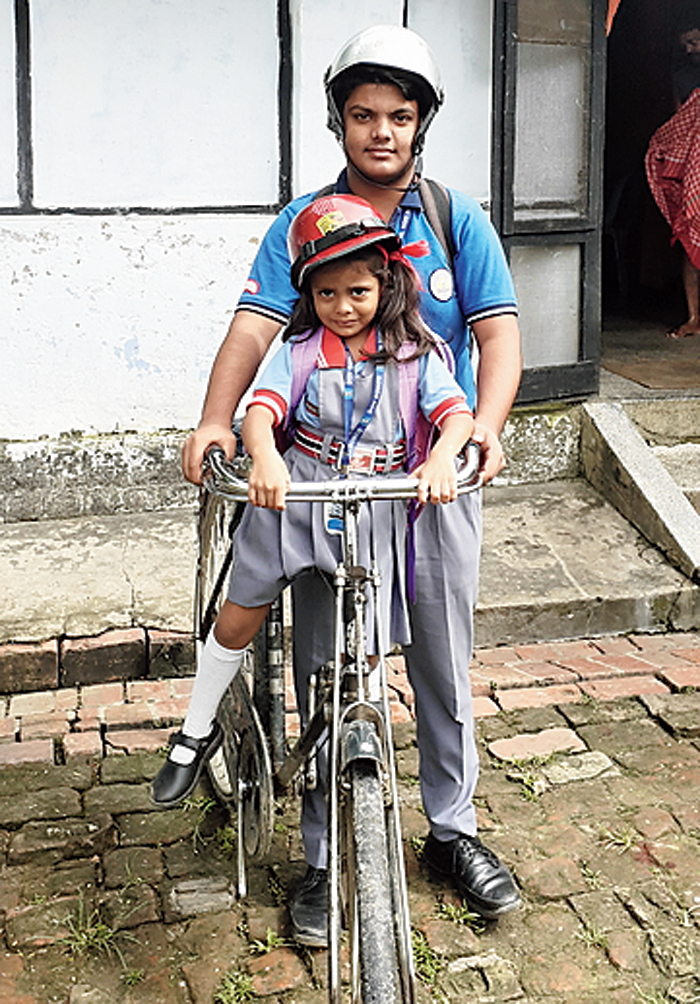 Hamant Rajak and Jiya proceed towards school from their residence on Wednesday