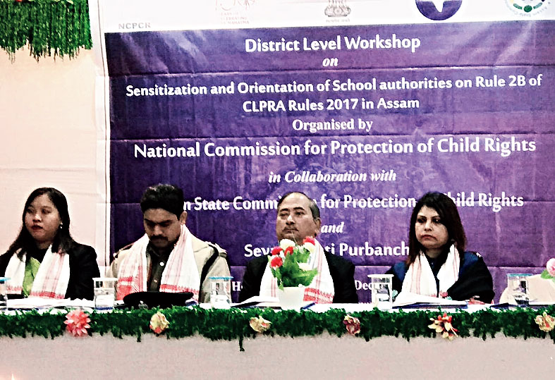 The dignitaries at the workshop on child rights and protection in Hojai