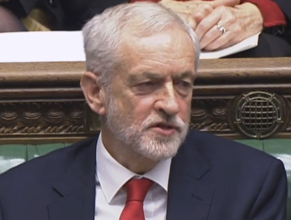 Labour leader Jeremy Corbyn says something under his breath after the British PM Theresa May likened Labour's attempt to table a no-confidence motion against her to a pantomime, during the weekly Prime Minister's Questions in the House of Commons in London on Wednesday.