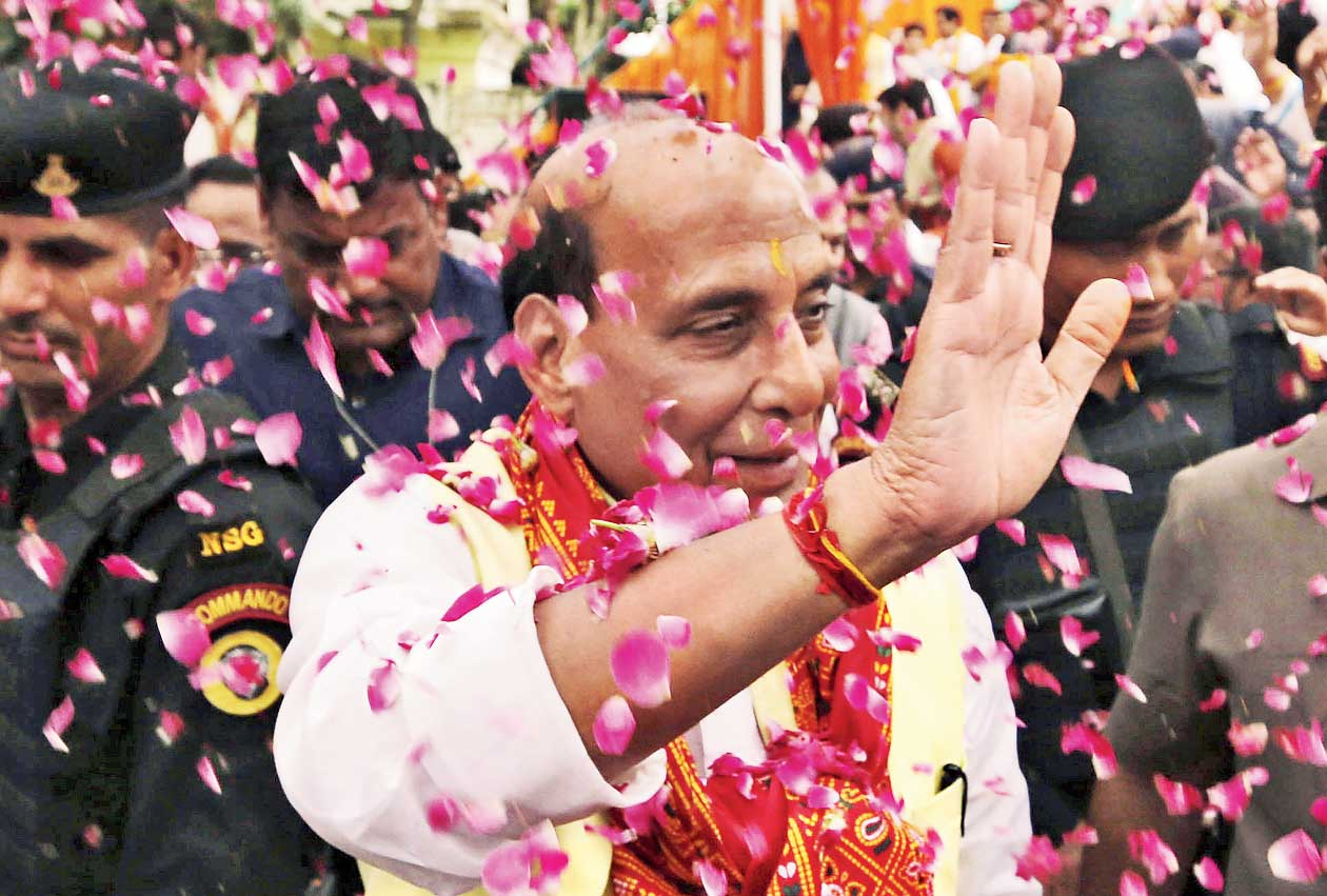 Union home minister Rajnath Singh arriving to file his nomination papers in Lucknow on April 16.
