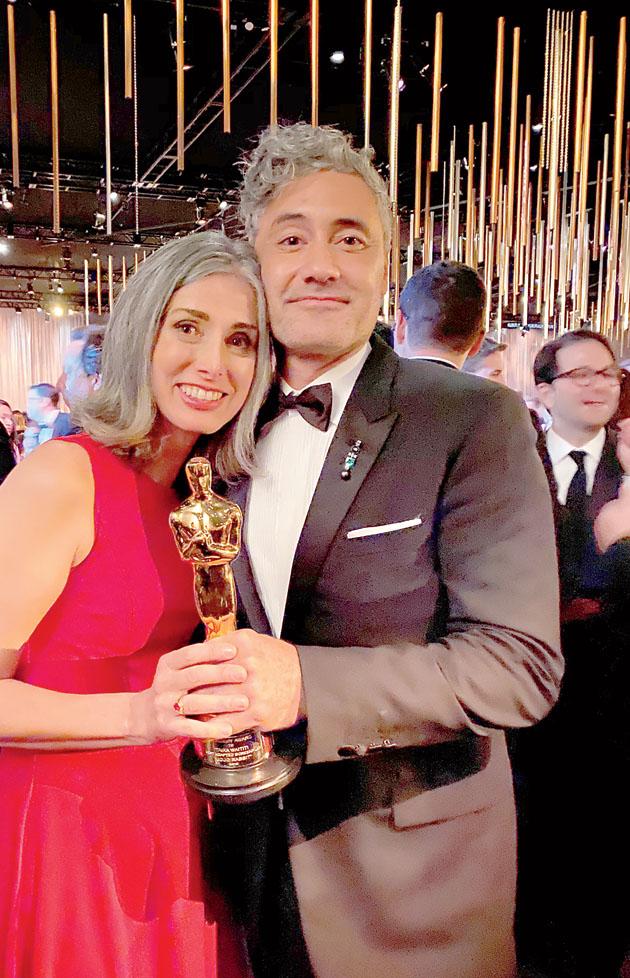 Christine Leunens with Taika Waititi at the Academy Awards 2020